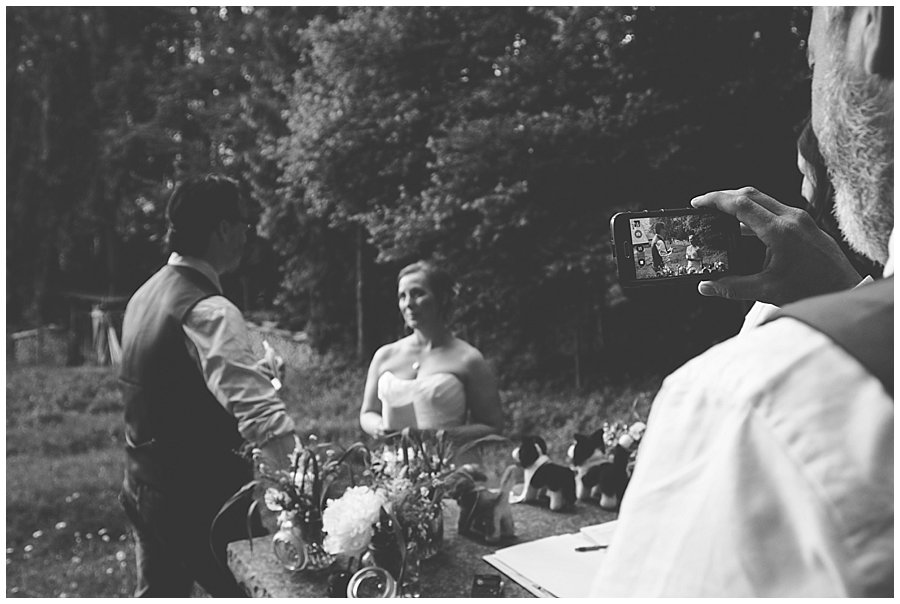 St Johann in Tirol Elopement best man Dave films the vows on his phone by Wild Connections Photography