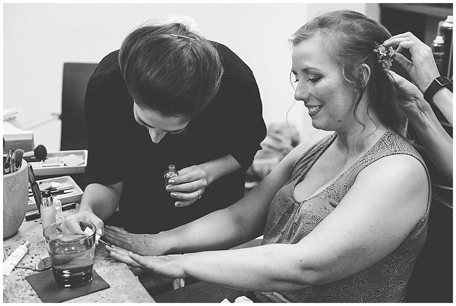 St Johann in Tirol Elopement Charlotte paints Nikki's nails at the salon by Wild Connections Photography