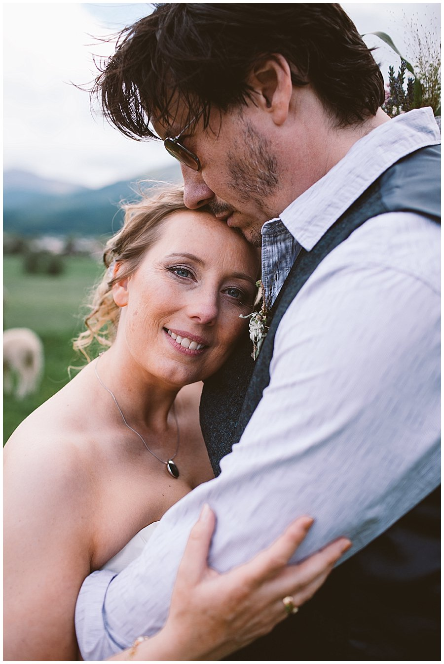 St Johann in Tirol Elopement as Nikki leans in to Chris, he kisses her on the head by Wild Connections Photography