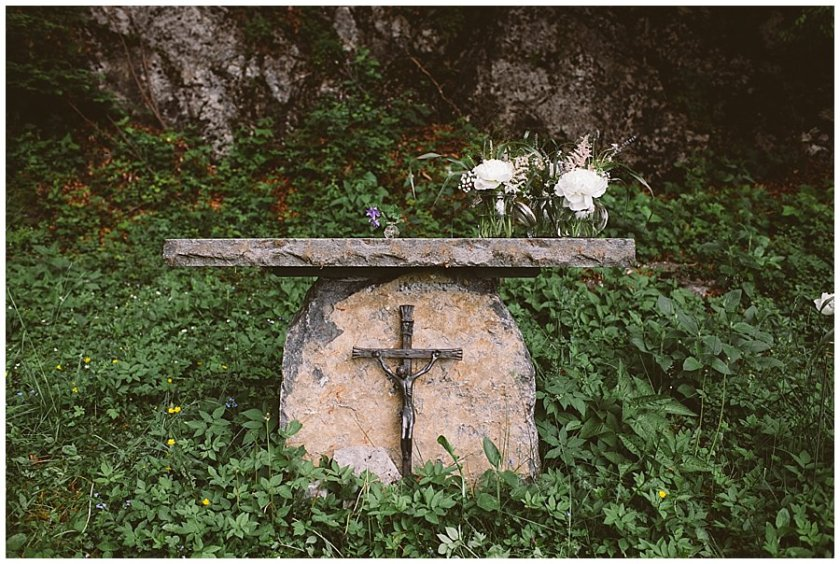 St Johann in Tirol Elopement a stone altar under a large rock face by Wild Connections Photography