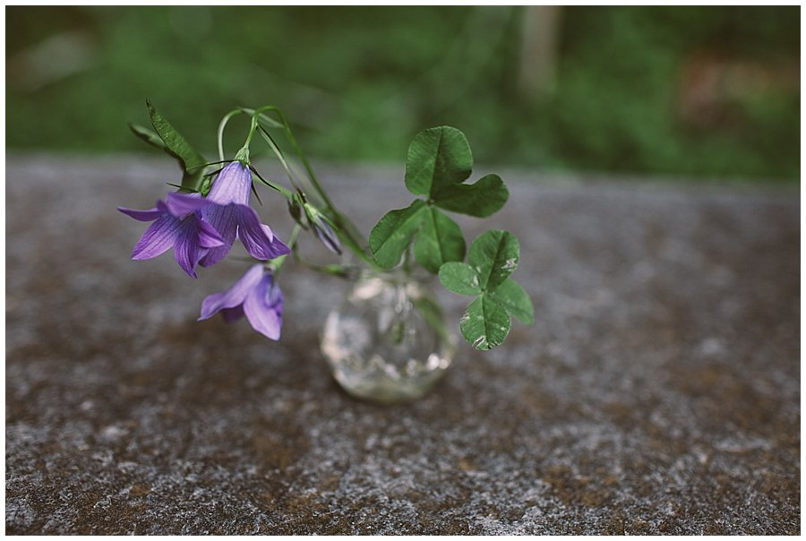 St Johann in Tirol Elopement two four-leaf clovers sit in a vase on the stone altar by Wild Connections Photography