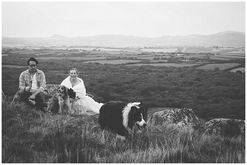 Wedding with Rescue Dogs - Husband and wife on mountain with rescue dogs by Wild Connections Photography