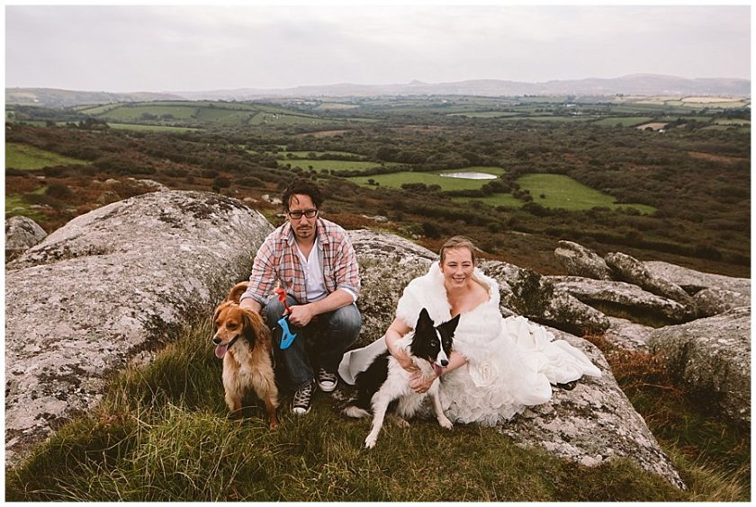 Wedding with Rescue Dogs - Husband and wife on mountain with two of their rescue dogs by Wild Connections Photography