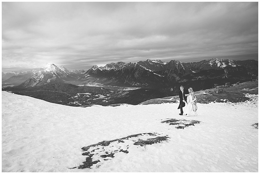 Seefeld Wedding The father of the bride walks his daughter Steph up the ski slope to her ceremony by Wild Connections Photography