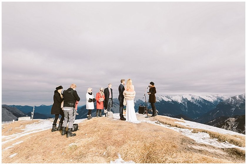 Steph and Lee stand on the top of the Seefelderjoch with their family for their mountain ceremony
