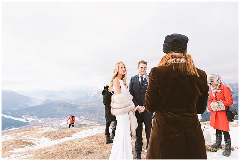 A hiker appears in the background of Steph and Lee's ceremony