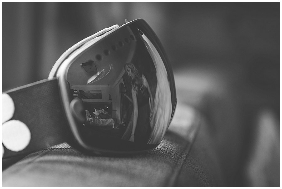 A reflection of the bridal suite in a pair of ski goggles