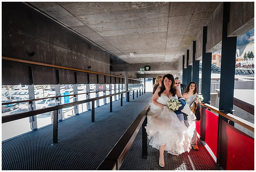 Mayrhofen Wedding bride walks up the ahorn cable car entrance ramp