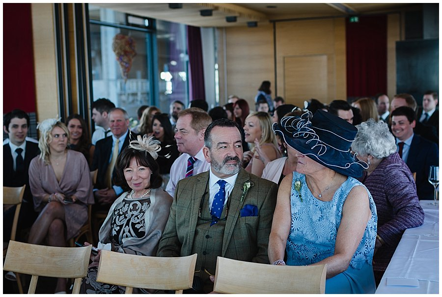 The wedding guests await the bride in the ceremony room