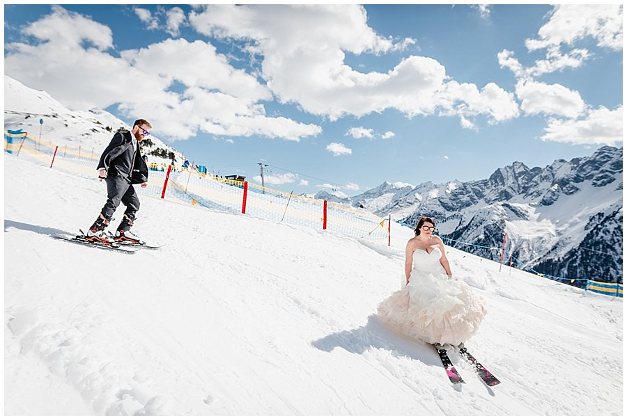 Bec and Dan skiing down the slope on the Ahorn in Mayrhofen in the wedding outfits