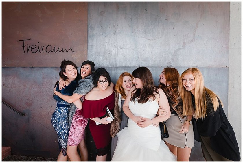 The bride and her girlfriends have a laugh during the group pictures