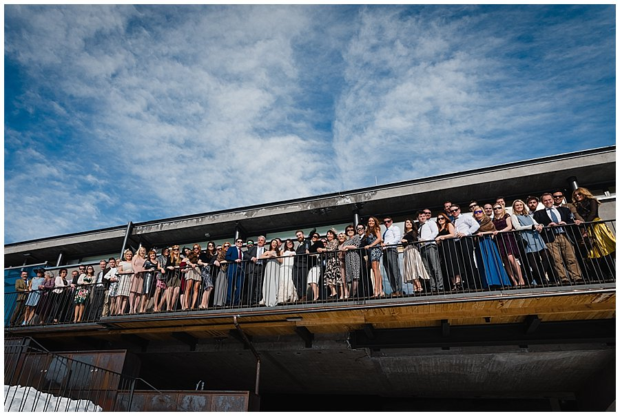 A shot of the entire wedding group on the balcony of the Freiraum reception venue