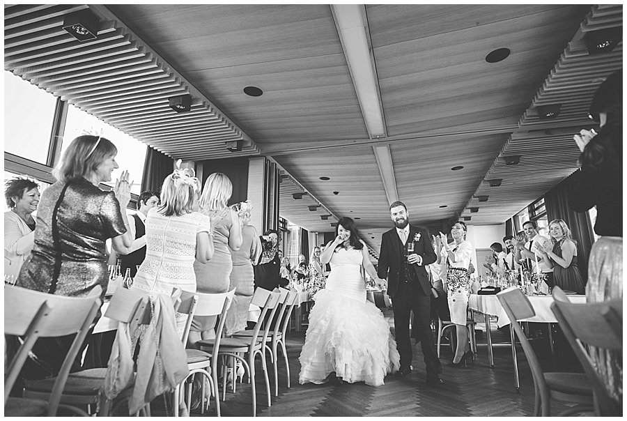 Bec and Dan enter their reception to a standing ovation