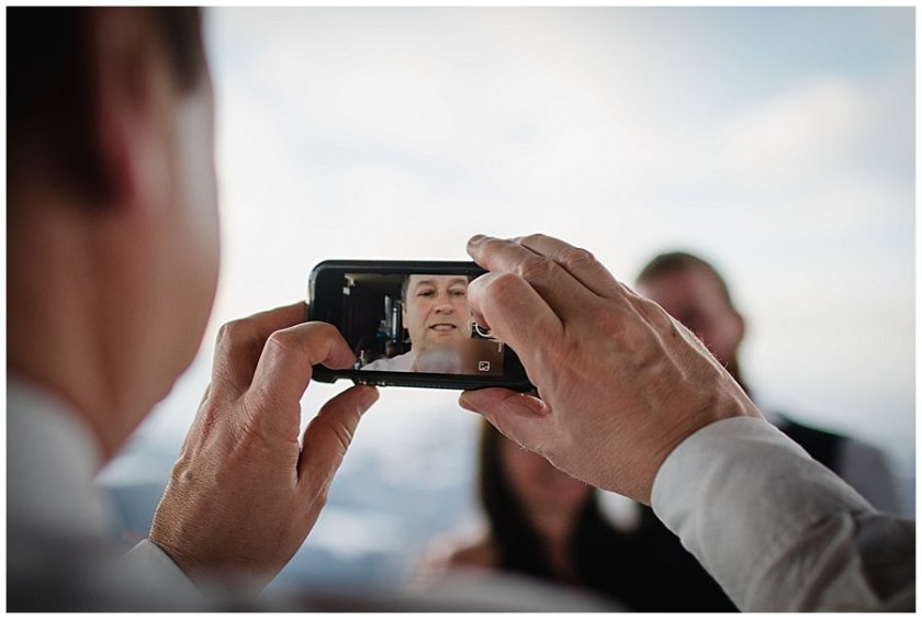 A guest goes to take a photo of the bride and groom and accidentally takes a selfie
