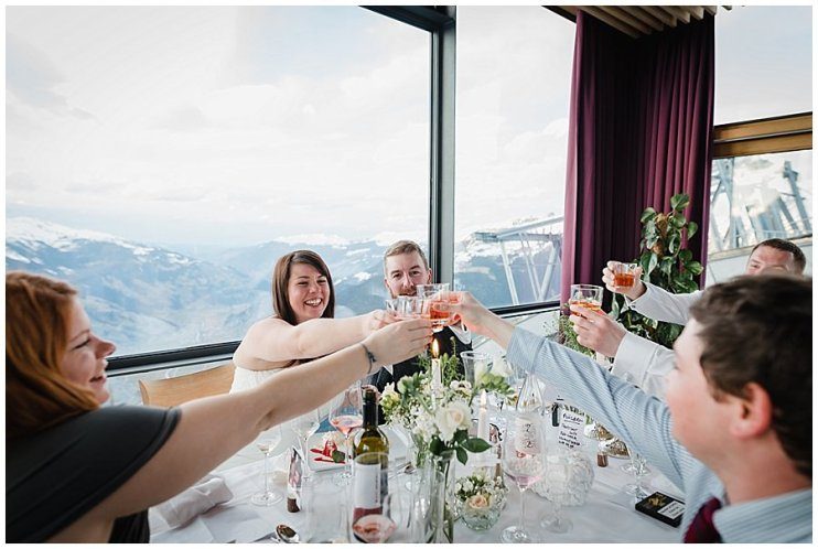 Wedding couple and guests raise their glasses with Flugerl cocktails at their ski resort wedding in Mayrhofen