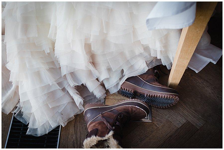 Bec's Sorel snow boots lie on the floor