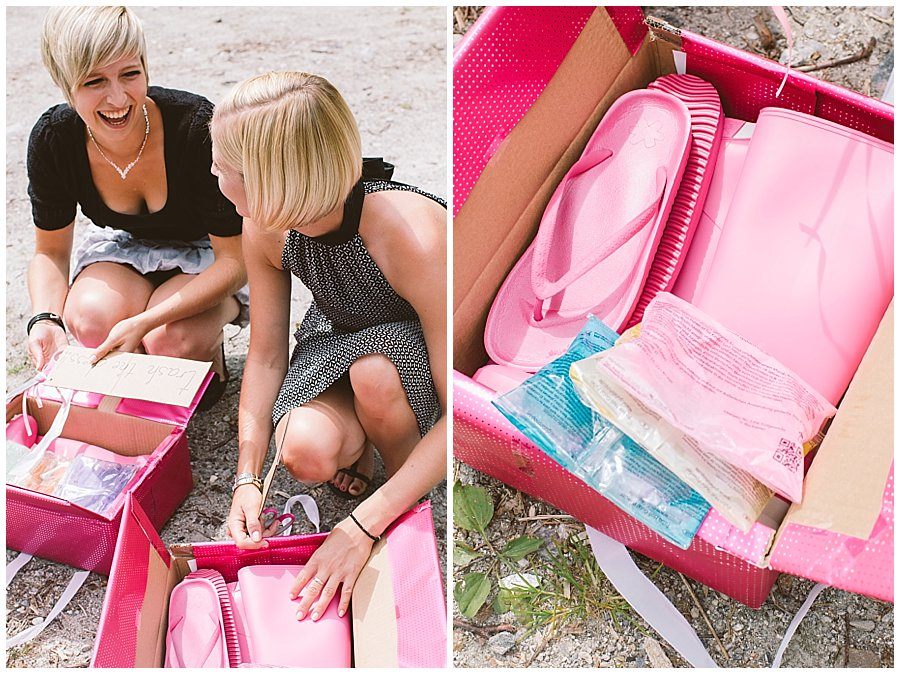 Trash The Dress Photo Shoot Austria - Sisters opening surprise packages with pink rubber boots and powder paint by Wild Connections Photography