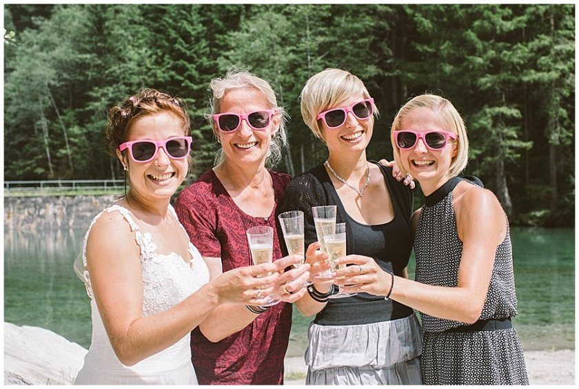 Trash The Dress Photo Shoot Austria - Girls toast with prosecco wearing pink sunglasses by Wild Connections Photography