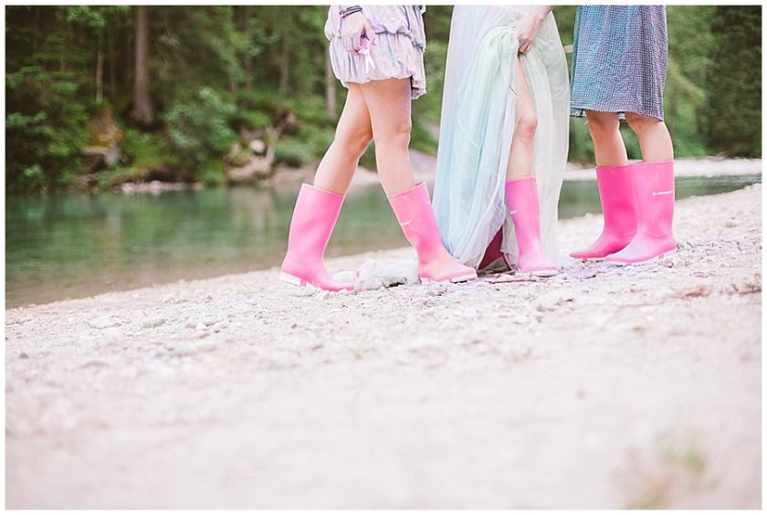 Trash The Dress Photo Shoot Austria - Bride and her sisters wearing pink wellingtons by Wild Connections Photography
