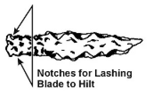 Cut notches in the stone blade to lash a hilt to
