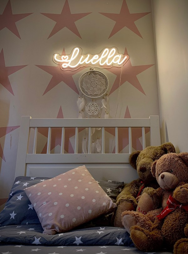 Personalised name neon bedroom light above bed