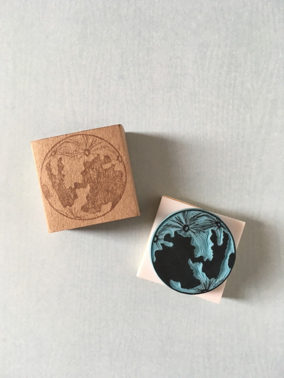 An adorable moon stamp carved by CassaStamps on Etsy