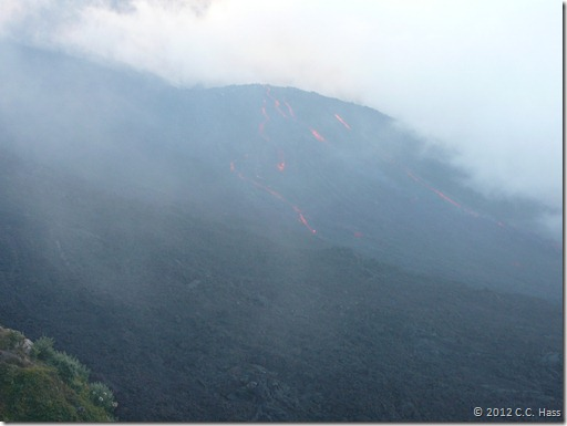 Red streams of lava flow into the crater of Pacaya Volcano