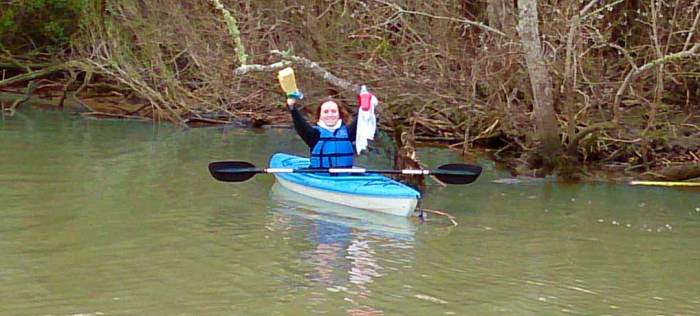 One successful paddler shows off her achievements after a Kayak Kleanup Tour