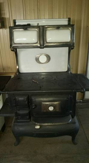 I'll be putting things on the back burner for real with our new/old wood or coal cook stove.