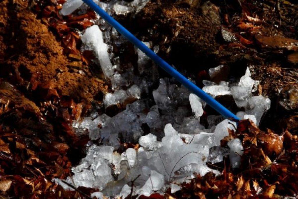 Ice all around the leak on the Wild Ozark spring water line.