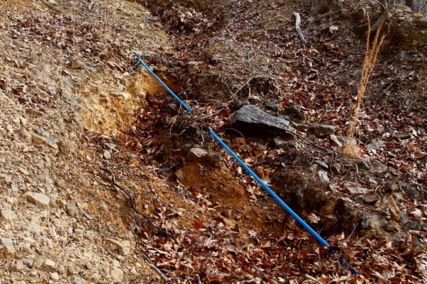 The water line is stretched tight because of the shifting ground and erosion.