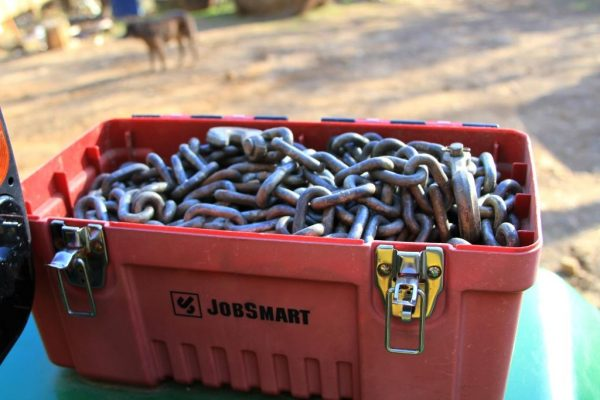 We keep the chains in a tool box mounted to the tractor fender.