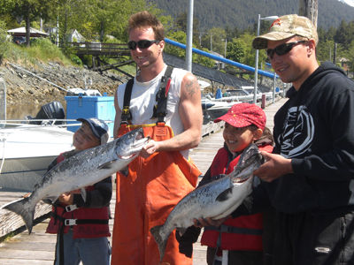 Big Brothers holding up Salmon