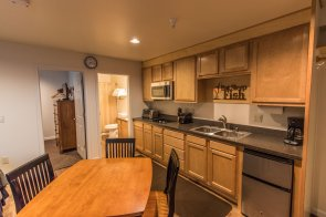 Wild Strawberry Lodge Suites small kitchens include toaster, toaster oven, microwave, stove top and refrigerator