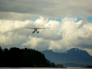 Float plane coming in for a landing in Eliason Harbor, Sitka, AK