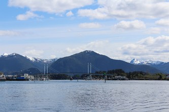 O'Connell bridge with a beautiful mountain background. The bridge connects Japonski to Baranof Island.