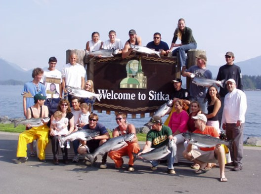 Welcome to Sitka sign with Alaska Premier Charters, Inc. Staff