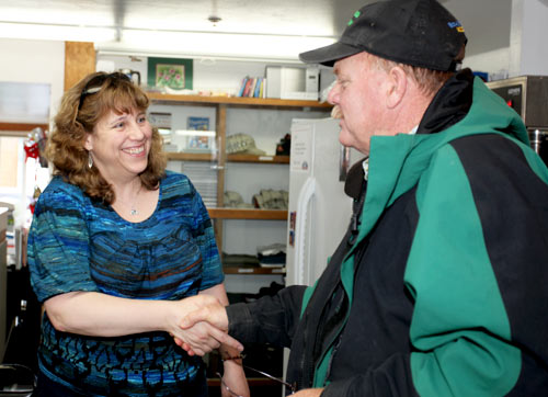 Theresa, the owner of Alaska Premier Charters, greets a client.