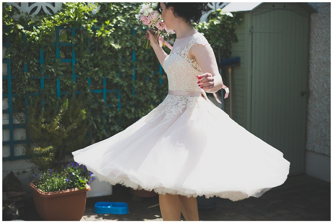 Bride twirling in a lace dress