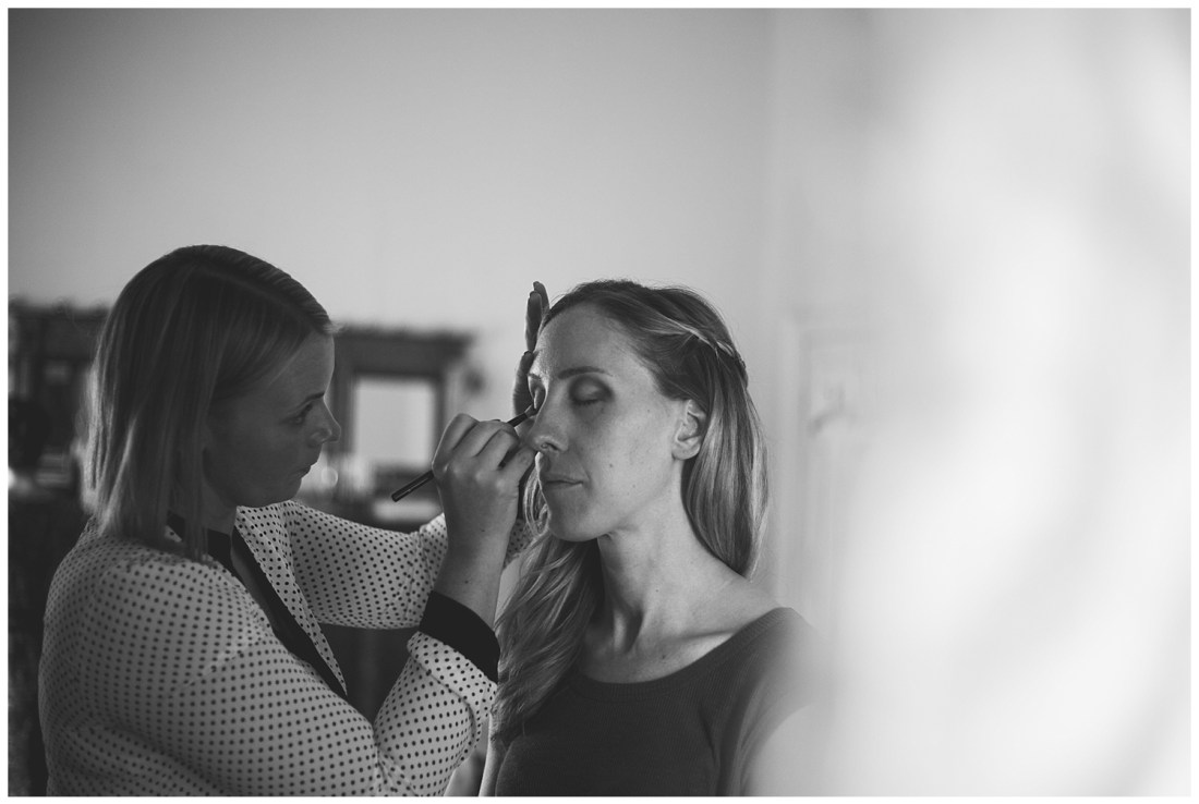 Make-up artist applying make-up at wedding