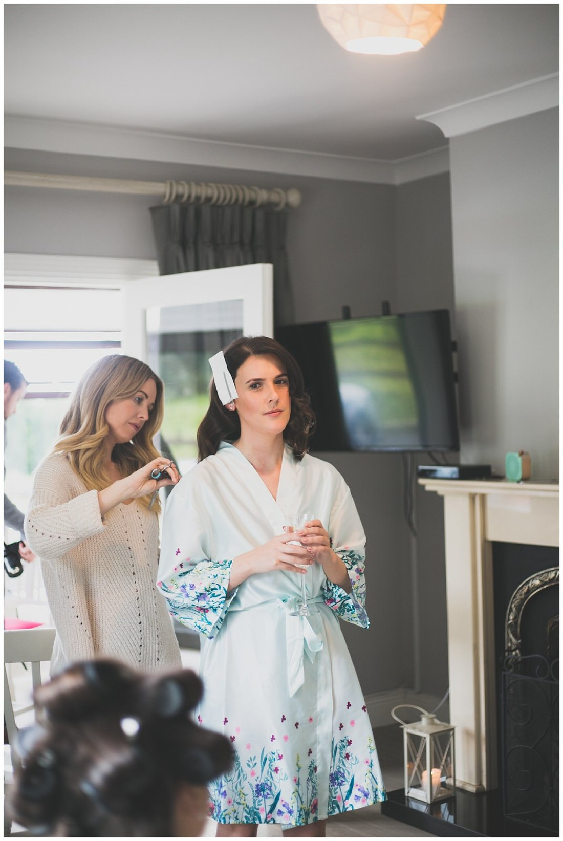 Bride getting her hair styled in to loose curls