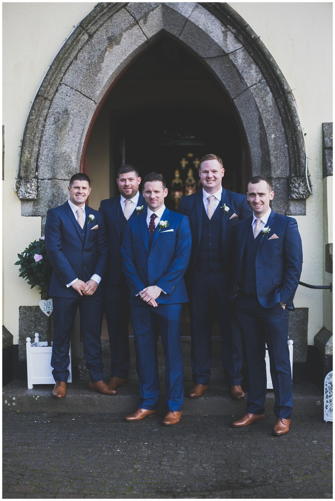 Groom and his groomsmen before the wedding ceremony