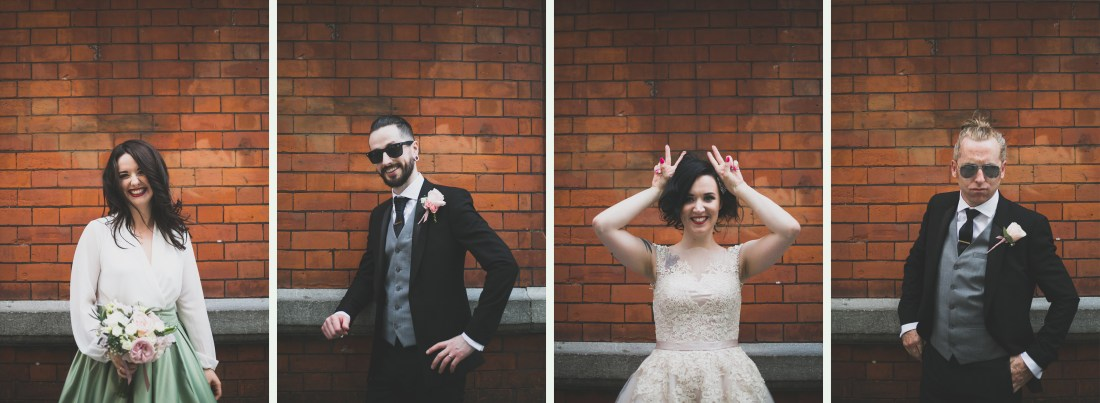 Red brick funny wedding portraits of bridal party and couple