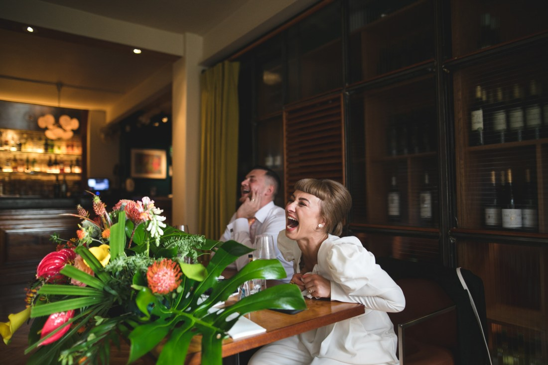 Laughing at wedding speeches in Drury Buildings Restaurant