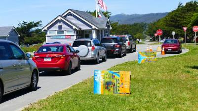 Pallet signs on display at Francis Beach parking entrance
