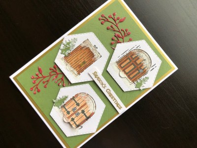 Hand made Christmas card with opening fairy doors and embossing powder snow