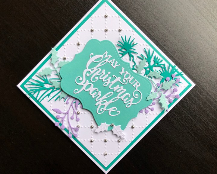 Christmas card with die cut sentiment and foliage