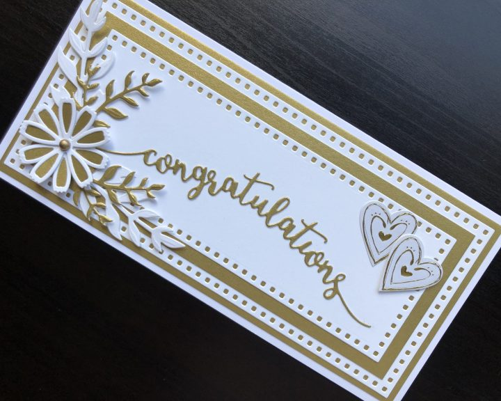 Hand made wedding card with die cut layers, flowers and sentiment.