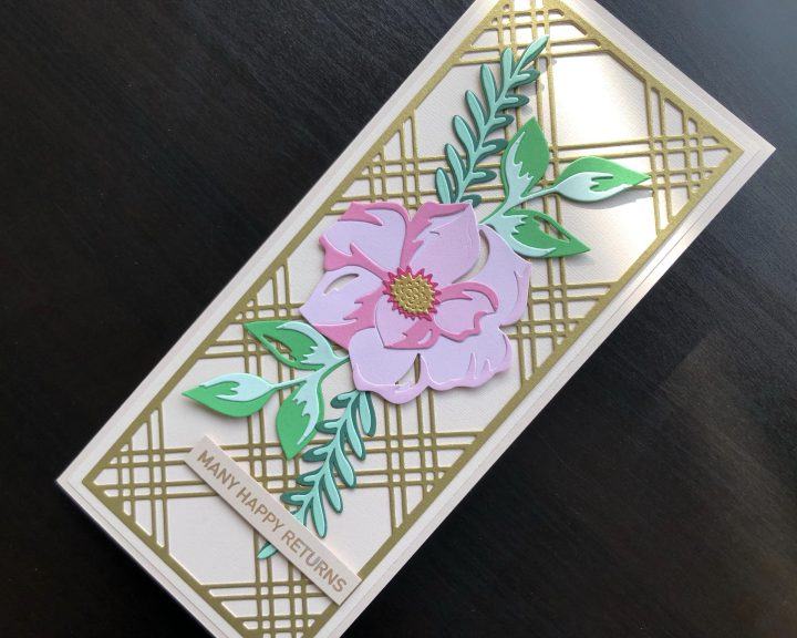 Hand made birthday card with die cut tartan background and flower