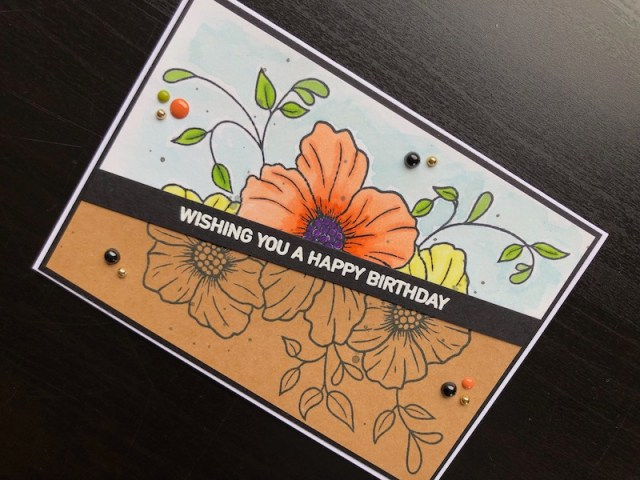 Petal Trio half and half stamping birthday card with heat embossed greeting.
